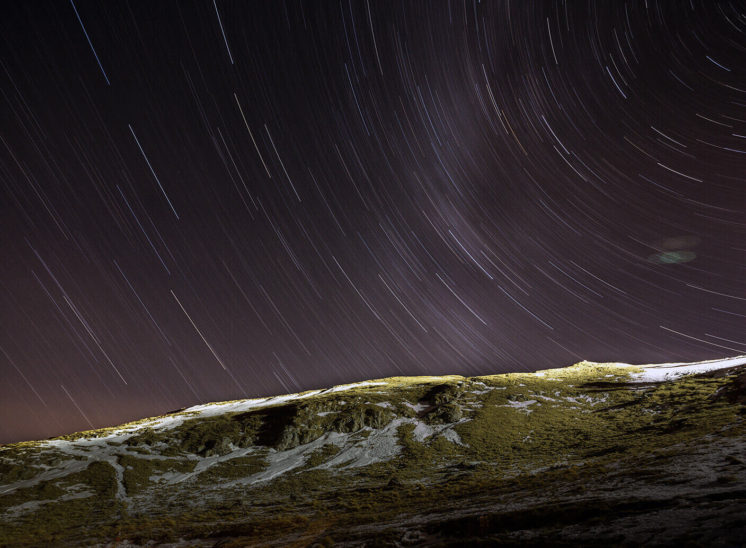 One hour exposure of the stars on the Carpathian mountains in Romania