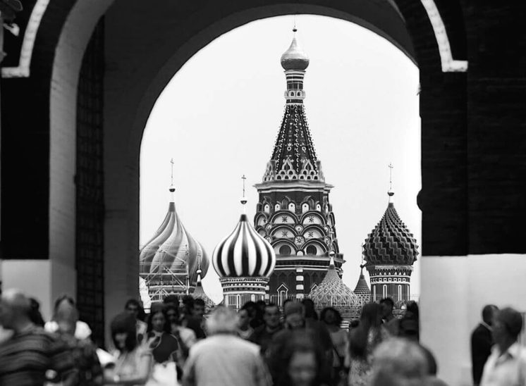 Crowded Red Square with the St. Basil Cathedral in the background in Moscow, Russia