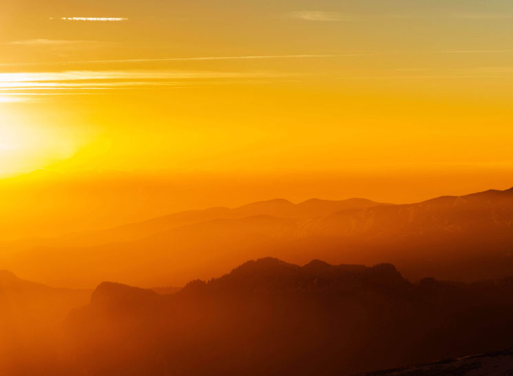 Silhouette of a mountain during sunset