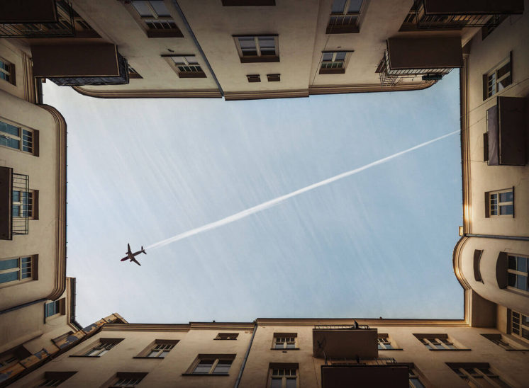 A plane flying across the sky